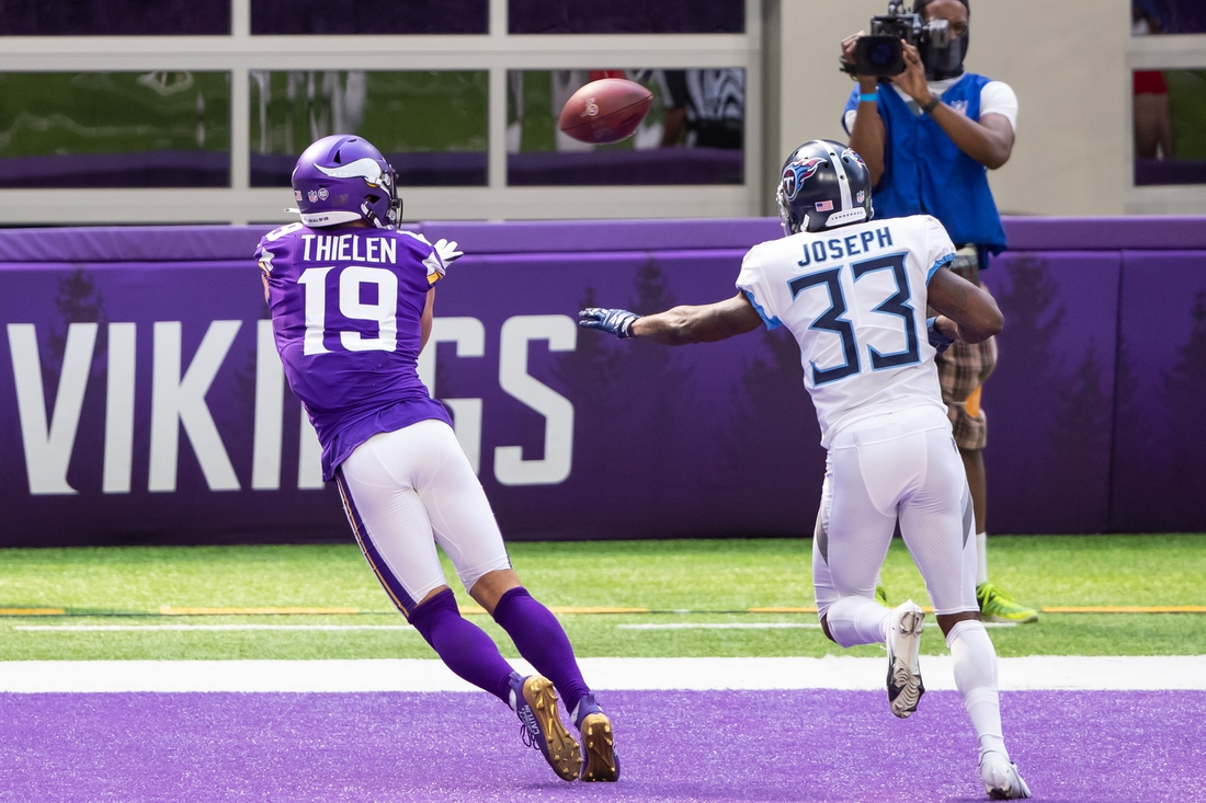 Sep 27, 2020; Minneapolis, Minnesota, USA; Minnesota Vikings wide receiver Adam Thielen (19) catches a pass for a touchdown in the second quarter against the Tennessee Titans defensive back Johnathan Joseph  (33) at U.S. Bank Stadium. Mandatory Credit: Brad Rempel-USA TODAY Sports