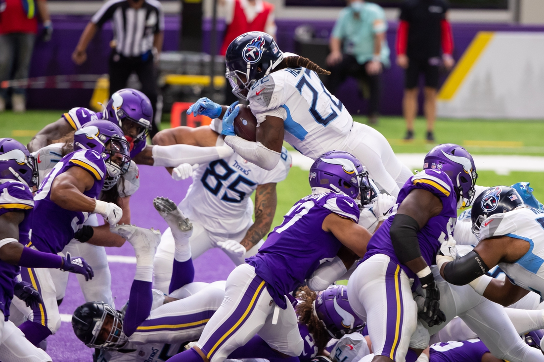 Sep 27, 2020; Minneapolis, Minnesota, USA; Tennessee Titans running back Derrick Henry (22) scores a touchdown in the third quarter against the Minnesota Vikings at U.S. Bank Stadium. Mandatory Credit: Brad Rempel-USA TODAY Sports