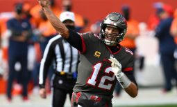 Sep 27, 2020; Denver, Colorado, USA; Tampa Bay Buccaneers quarterback Tom Brady (12) throws a touchdown pass in the first quarter against the Denver Broncos at Empower Field at Mile High. Mandatory Credit: Ron Chenoy-USA TODAY Sports