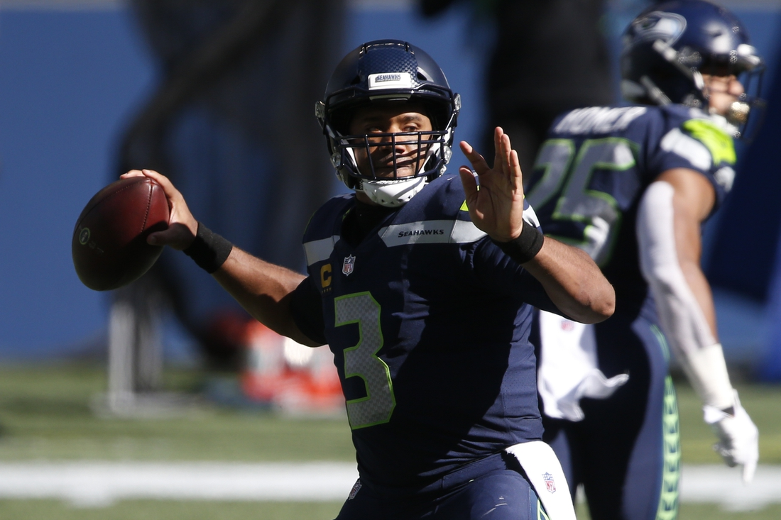 Sep 27, 2020; Seattle, Washington, USA; Seattle Seahawks quarterback Russell Wilson (3) passes against the Dallas Cowboys during the second quarter at CenturyLink Field. Mandatory Credit: Joe Nicholson-USA TODAY Sports