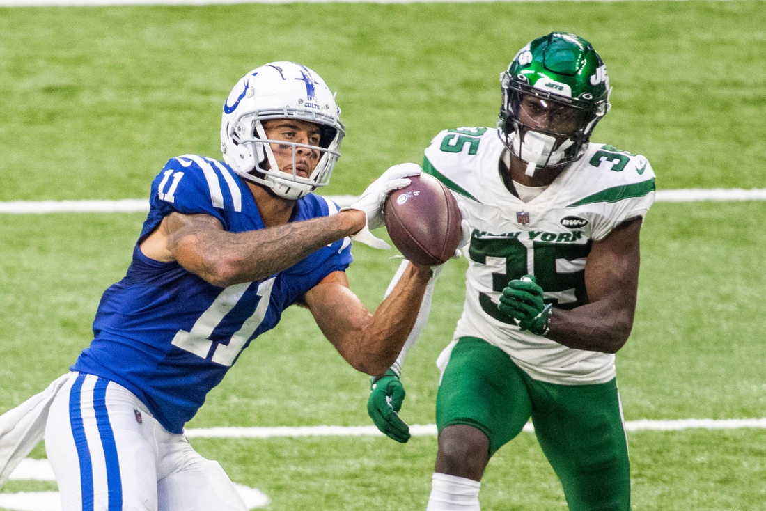 Sep 27, 2020; Indianapolis, Indiana, USA; Indianapolis Colts wide receiver Michael Pittman (11) catches the ball while New York Jets cornerback Pierre Desir (35) defends in the second half at Lucas Oil Stadium. Mandatory Credit: Trevor Ruszkowski-USA TODAY Sports