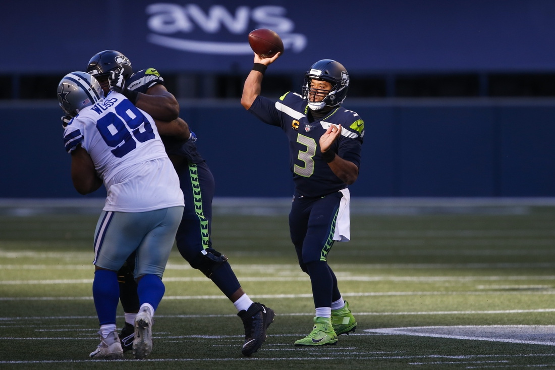 Sep 27, 2020; Seattle, Washington, USA; Seattle Seahawks quarterback Russell Wilson (3) passes against the Dallas Cowboys during the fourth quarter at CenturyLink Field. Mandatory Credit: Joe Nicholson-USA TODAY Sports
