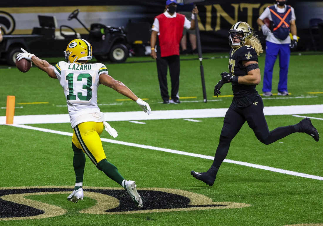 Sep 27, 2020; New Orleans, Louisiana, USA; Green Bay Packers wide receiver Allen Lazard (13) celebrates after a touchdown against the New Orleans Saints during the second quarter at the Mercedes-Benz Superdome. Mandatory Credit: Derick E. Hingle-USA TODAY Sports