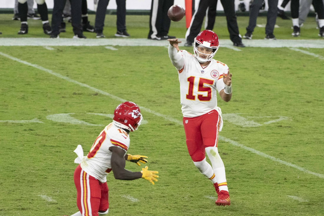 Sep 28, 2020; Baltimore, Maryland, USA;  Kansas City Chiefs quarterback Patrick Mahomes (15) throws to wide receiver Tyreek Hill (10) during the second half against the Baltimore Ravens at M&T Bank Stadium. Mandatory Credit: Tommy Gilligan-USA TODAY Sports