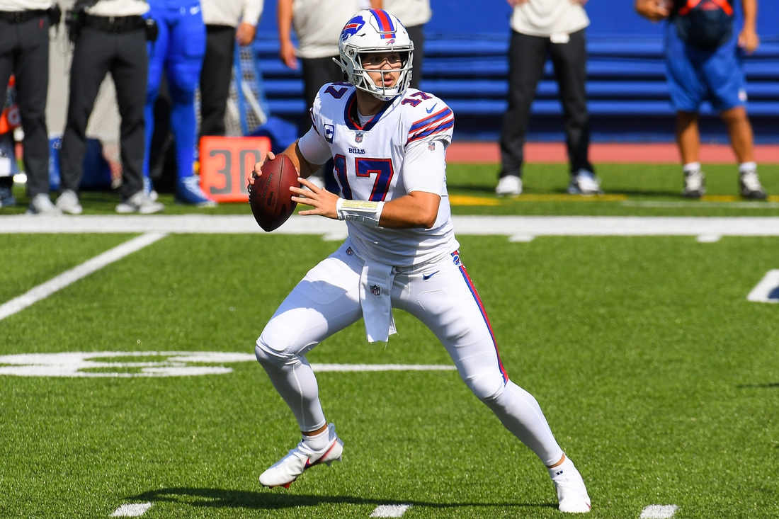 Sep 27, 2020; Orchard Park, New York, USA; Buffalo Bills quarterback Josh Allen (17) drops back to pass against the Los Angeles Rams during the first quarter at Bills Stadium. Mandatory Credit: Rich Barnes-USA TODAY Sports