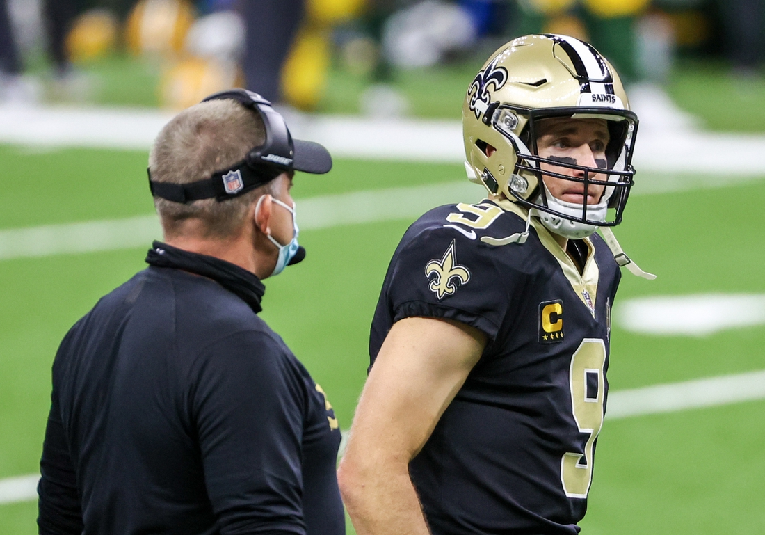 Sep 27, 2020; New Orleans, Louisiana, USA; New Orleans Saints quarterback Drew Brees (9) with New Orleans Saints head coach Sean Payton during the second quarter against the Green Bay Packers at the Mercedes-Benz Superdome. Mandatory Credit: Derick E. Hingle-USA TODAY Sports