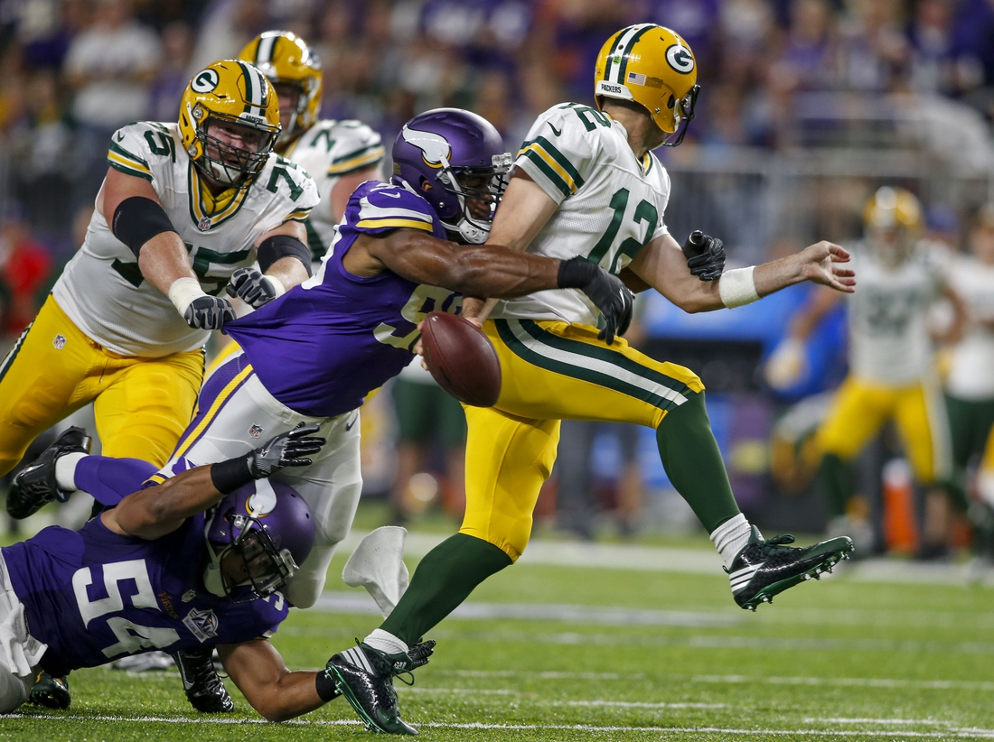 Sep 18, 2016; Minneapolis, MN, USA; Minnesota Vikings defensive end Danielle Hunter (99) sacks Green Bay Packers quarterback Aaron Rodgers (12) and forces a fumble in the first quarter at U.S. Bank Stadium. Mandatory Credit: Bruce Kluckhohn-USA TODAY Sports