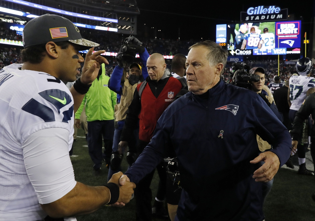 Nov 13, 2016; Foxborough, MA, USA; New England Patriots head coach Bill Belichick greets Seattle Seahawks quarterback Russell Wilson (3) after the game at Gillette Stadium. Seattle Seahawks defeated the Patriots 31-24. Mandatory Credit: David Butler II-USA TODAY Sports