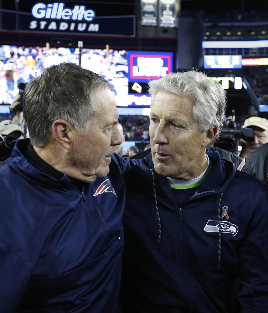 Nov 13, 2016; Foxborough, MA, USA;  New England Patriots head coach Bill Belichick and Seattle Seahawks head coach Pete Carroll greet after the game at Gillette Stadium.  The Seattle Seahawks won 31-24.  Mandatory Credit: Greg M. Cooper-USA TODAY Sports