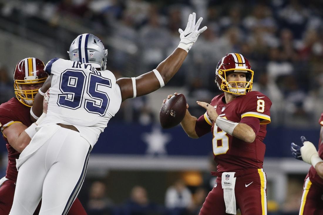 Nov 30, 2017; Arlington, TX, USA;  Washington Redskins quarterback Kirk Cousins (8) throws a pass against Dallas Cowboys defensive tackle David Irving (95) in the first quarter at AT&T Stadium. Mandatory Credit: Tim Heitman-USA TODAY Sports