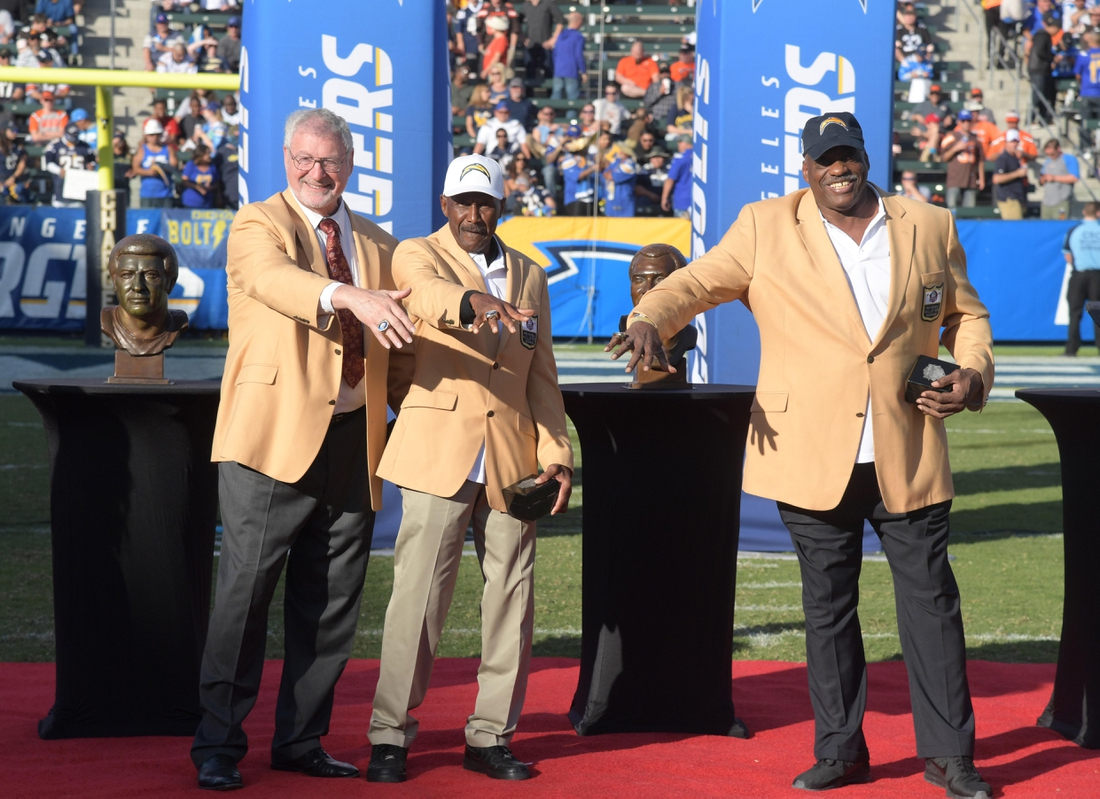 Dec 3, 2017; Carson, CA, USA; San Diego Chargers former players Ron Mix (left), Charlie Joiner (center) and Fred Dean are honored during a Pro Football Hall of Fame ring of excellence ceremony during an NFL football game between the Cleveland Browns and the Los Angeles Chargers at StubHub Center. Mandatory Credit: Kirby Lee-USA TODAY Sports