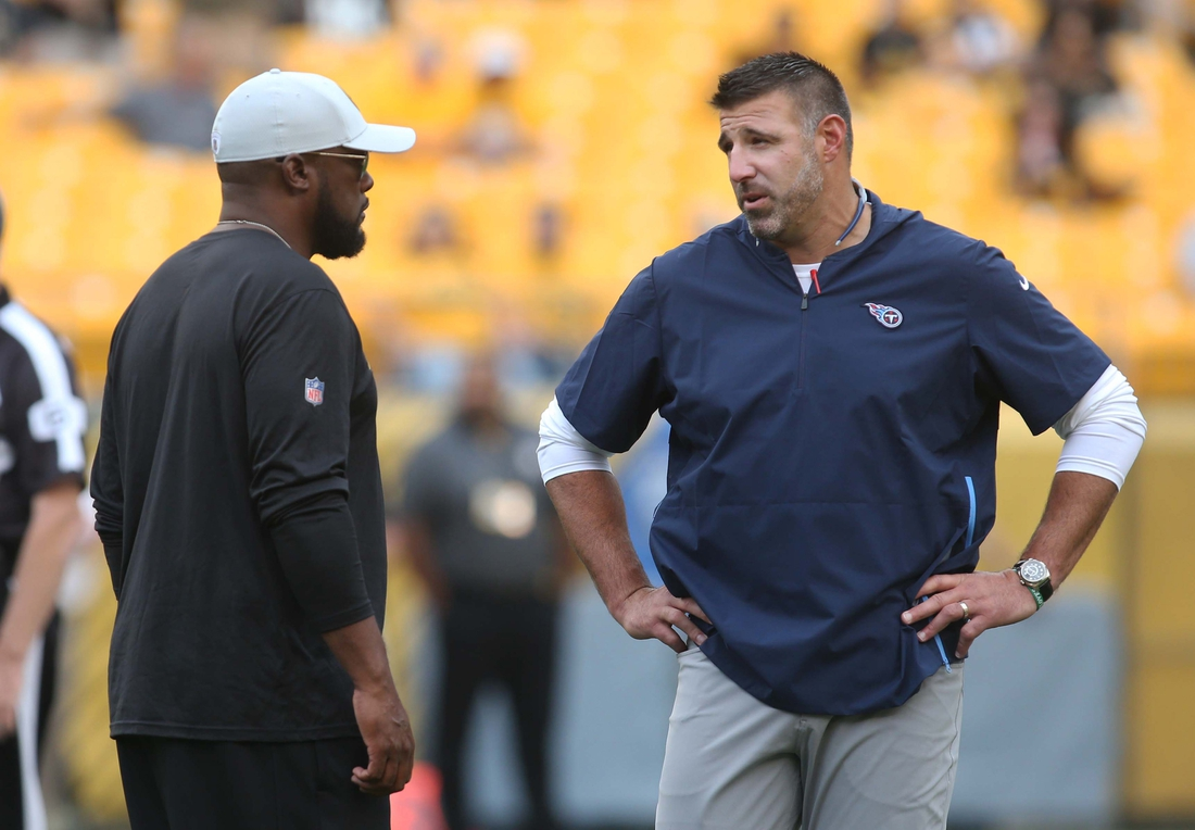 Aug 25, 2018; Pittsburgh, PA, USA;  Pittsburgh Steelers head coach Mike Tomlin (L) and Tennessee Titans head coach Mike Vrabel (R) talk before their game at Heinz Field. Mandatory Credit: Charles LeClaire-USA TODAY Sports