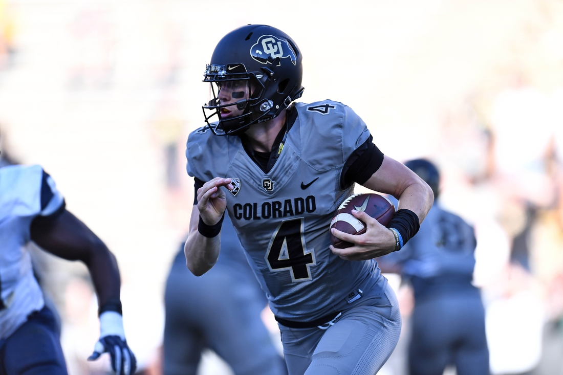Sep 15, 2018; Boulder, CO, USA; Colorado Buffaloes quarterback Sam Noyer (4) scrambles with the ball in the second half of the game against the New Hampshire Wildcats at Folsom Field. Mandatory Credit: Ron Chenoy-USA TODAY Sports