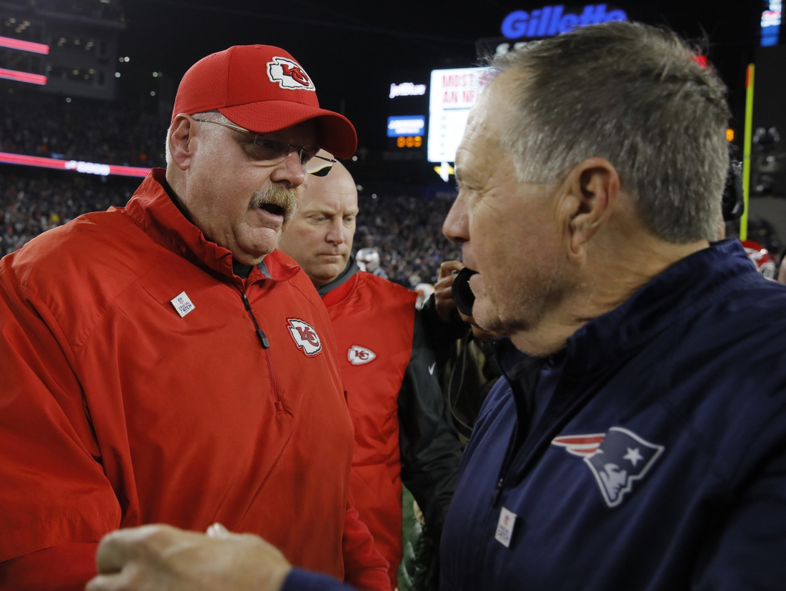 Oct 14, 2018; Foxborough, MA, USA; Kansas City Chiefs head coach Andy Reid meets New England Patriots head coach Bill Belichick after the game at Gillette Stadium. The Patriots defeated Kansas City 43-40. Mandatory Credit: David Butler II-USA TODAY Sports
