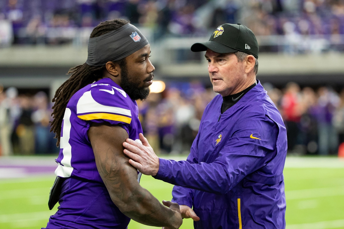 Dec 30, 2018; Minneapolis, MN, USA; Minnesota Vikings head coach Mike Zimmer and running back Dalvin Cook (33) meet before the game against Chicago Bears at U.S. Bank Stadium. Mandatory Credit: Brad Rempel-USA TODAY Sports