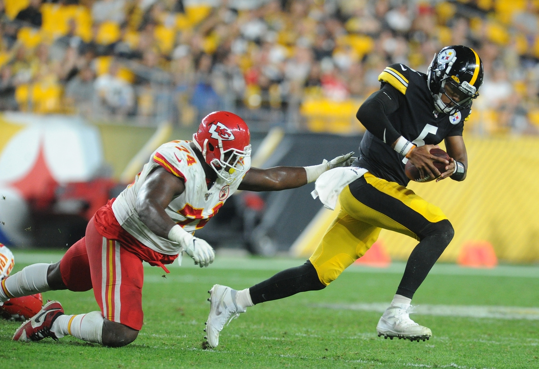Aug 17, 2019; Pittsburgh, PA, USA; Pittsburgh Steelers quarterback Joshua Dobbs (5) runs from Kansas City Chiefs defensive tackle Justin Hamilton (74) during the third quarter at Heinz Field. Mandatory Credit: Philip G. Pavely-USA TODAY Sports