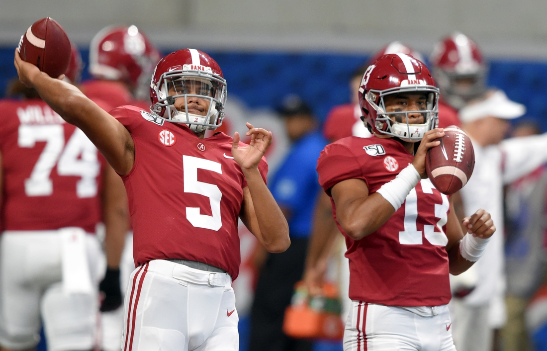 Aug 31, 2019; Atlanta, GA, USA; Alabama Crimson Tide quarterback Taulia Tagovailoa (5) throws the ball next to his brother quarterback Tua Tagovailoa (13) before the start of their game against the Duke Blue Devils at Mercedes-Benz Stadium. Mandatory Credit: John David Mercer-USA TODAY Sports