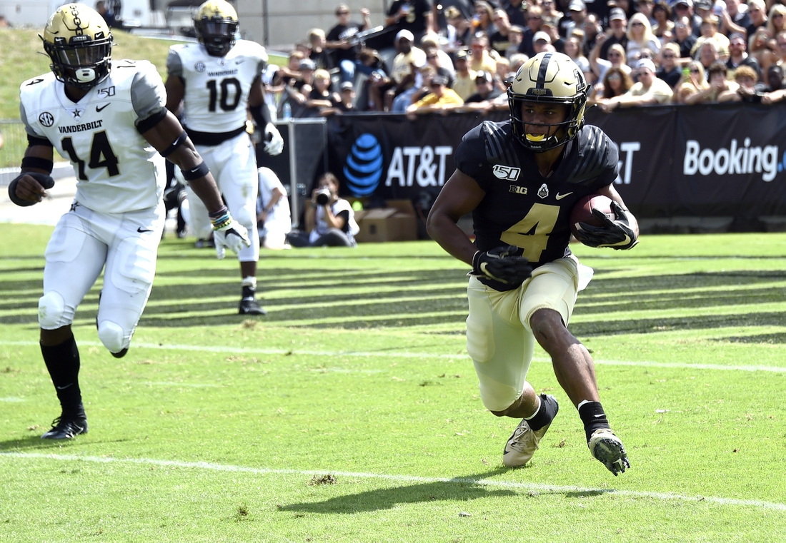 Sep 7, 2019; West Lafayette, IN, USA;  Purdue Boilermakers wide receiver Rondale Moore (4) runs the ball against Vanderbilt Commodores safety Max Worship (14) at Ross-Ade Stadium. Mandatory Credit: Sandra Dukes-USA TODAY Sports