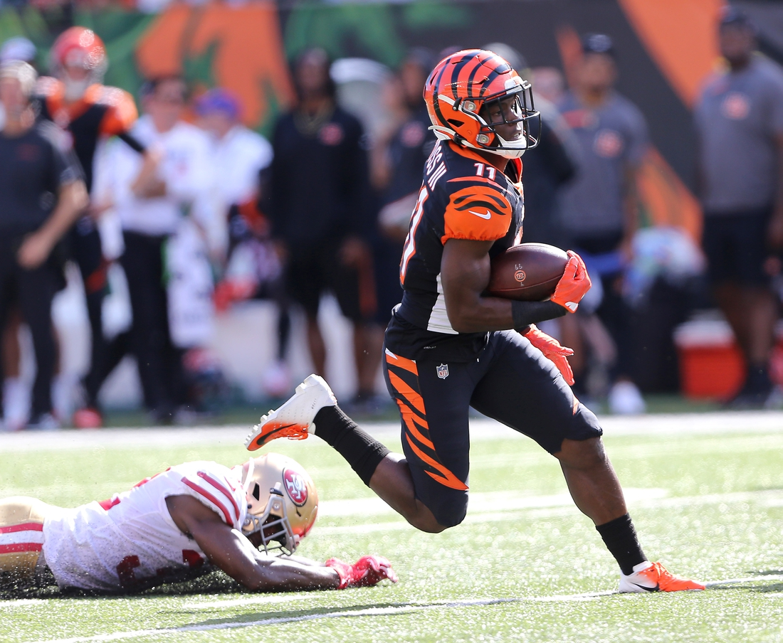 Sep 15, 2019; Cincinnati, OH, USA; Cincinnati Bengals wide receiver John Ross (11) breaks free for a touchdown during the fourth quarter against the San Francisco 49ers at Paul Brown Stadium. Mandatory Credit: Joe Maiorana-USA TODAY Sports