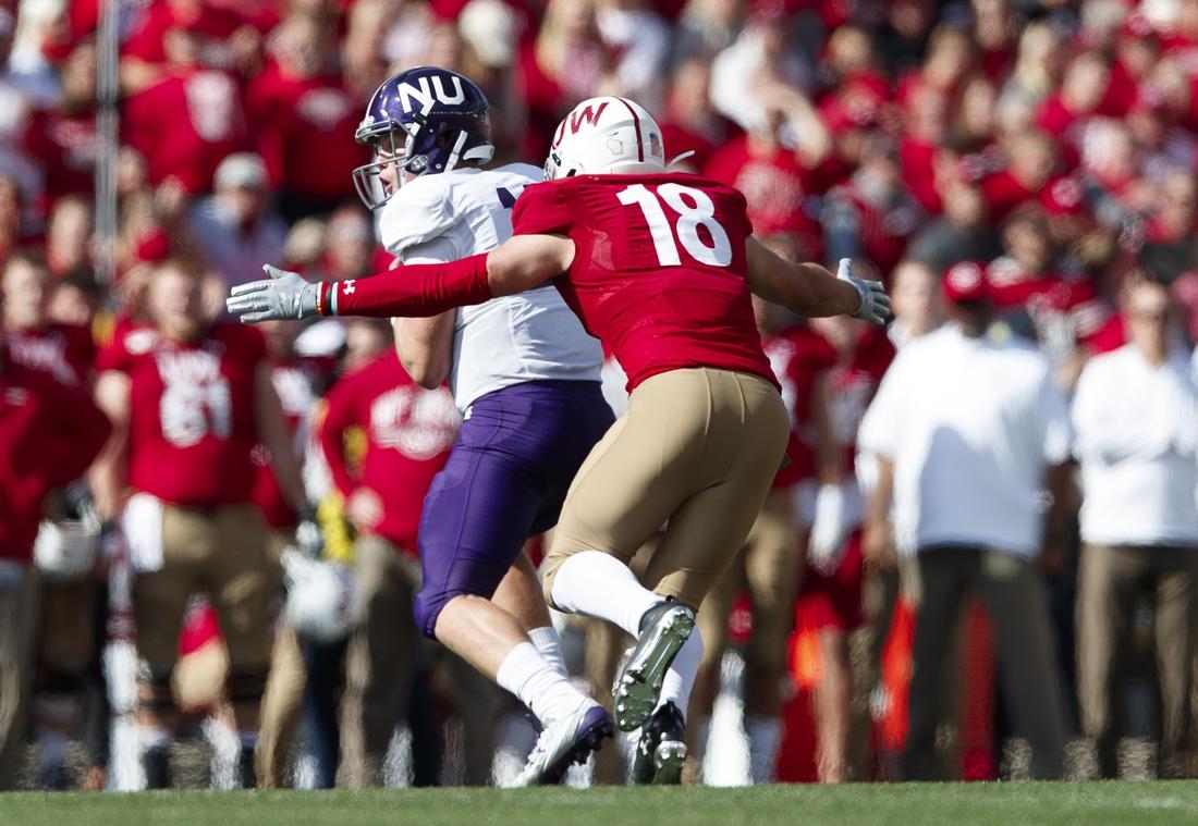 Sep 28, 2019; Madison, WI, USA; Wisconsin Badgers safety Collin Wilder (18) sacks Northwestern Wildcats quarterback Aidan Smith (11) during the fourth quarter at Camp Randall Stadium. Mandatory Credit: Jeff Hanisch-USA TODAY Sports
