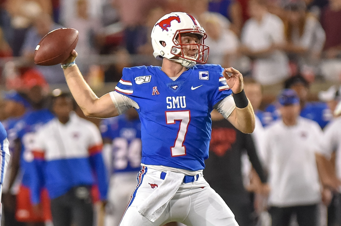 Oct 5, 2019; Dallas, TX, USA; SMU Mustangs quarterback Shane Buechele (7) looks downfield during the second quarter against Tulsa Golden Hurricanes at Gerald J. Ford Stadium. Mandatory Credit: Timothy Flores-USA TODAY Sports