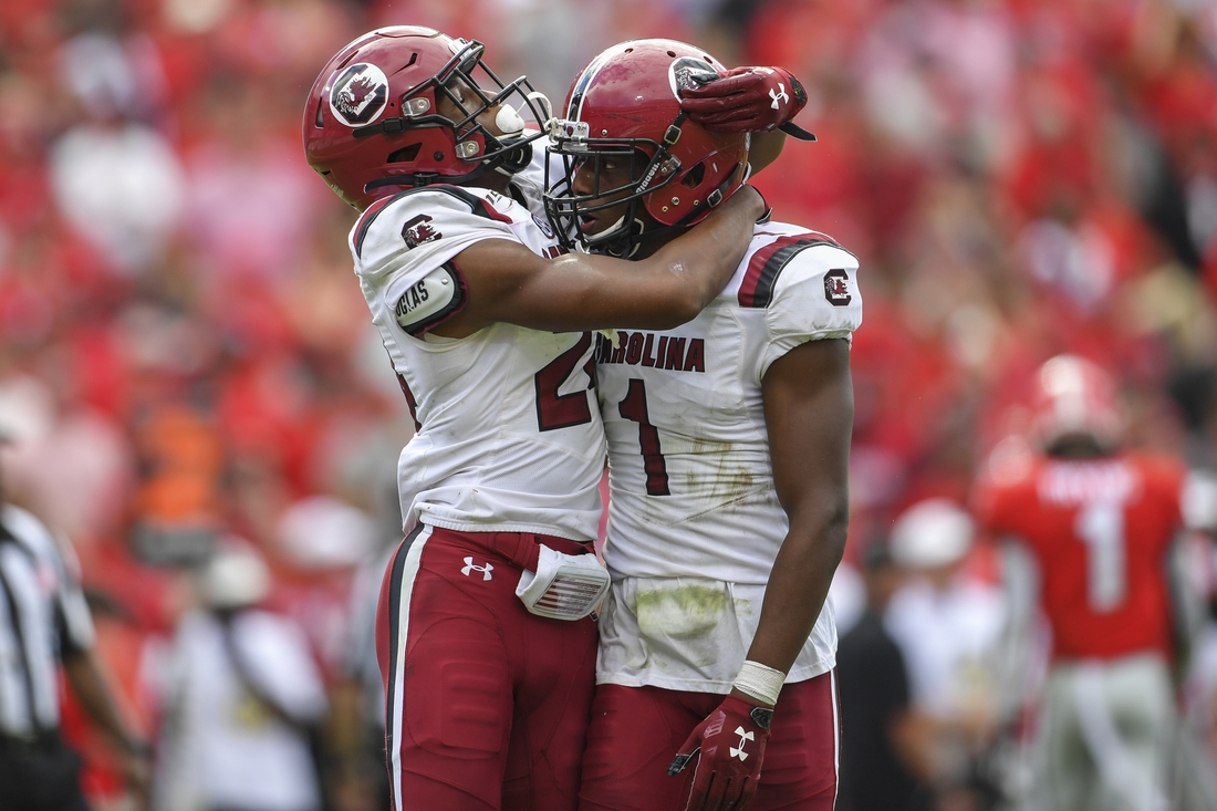 Oct 12, 2019; Athens, GA, USA; South Carolina Gamecocks defensive back Israel Mukuamu (24) reacts with defensive back Jaycee Horn (1) after intercepting a pass against the Georgia Bulldogs during the first overtime at Sanford Stadium. Mandatory Credit: Dale Zanine-USA TODAY Sports