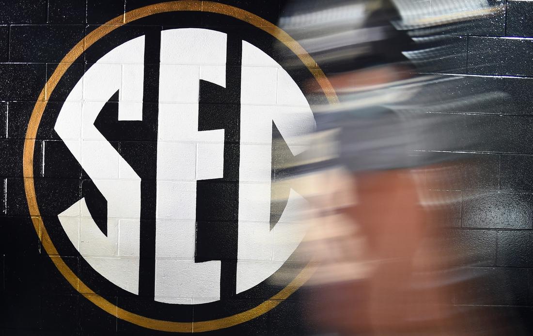 Oct 19, 2019; Nashville, TN, USA; General view of an SEC logo as a Vanderbilt Commodores player walks to the locker room before the game against the Missouri Tigers at Vanderbilt Stadium. Mandatory Credit: Christopher Hanewinckel-USA TODAY Sports