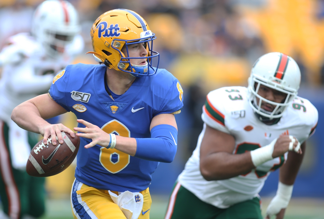 Oct 26, 2019; Pittsburgh, PA, USA;   Pittsburgh Panthers quarterback Kenny Pickett (8) scrambles with the ball as Miami Hurricanes defensive lineman Pat Bethel (93) chases during the first quarter at Heinz Field. Mandatory Credit: Charles LeClaire-USA TODAY Sports