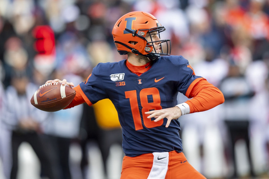 Nov 2, 2019; Champaign, IL, USA; Illinois Fighting Illini quarterback Brandon Peters (18) throws a pass against the Rutgers Scarlet Knights during the first half at Memorial Stadium. Mandatory Credit: Patrick Gorski-USA TODAY Sports