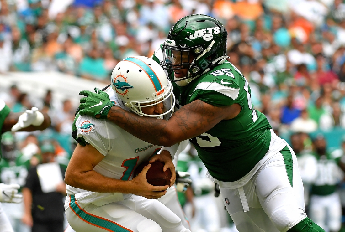 Nov 3, 2019; Miami Gardens, FL, USA; New York Jets defensive tackle Quinnen Williams (95) sacks Miami Dolphins quarterback Ryan Fitzpatrick (14) during the first half at Hard Rock Stadium. Mandatory Credit: Steve Mitchell-USA TODAY Sports