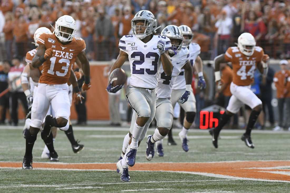 Nov 9, 2019; Austin, TX, USA; Kansas Jayhawks kick returner Joshua Youngblood (23) is chased by wide receiver Brennan Eagles (13) while returning the kick for a touchdown in the second half at Darrell K Royal-Texas Memorial Stadium. Mandatory Credit: Scott Wachter-USA TODAY Sports