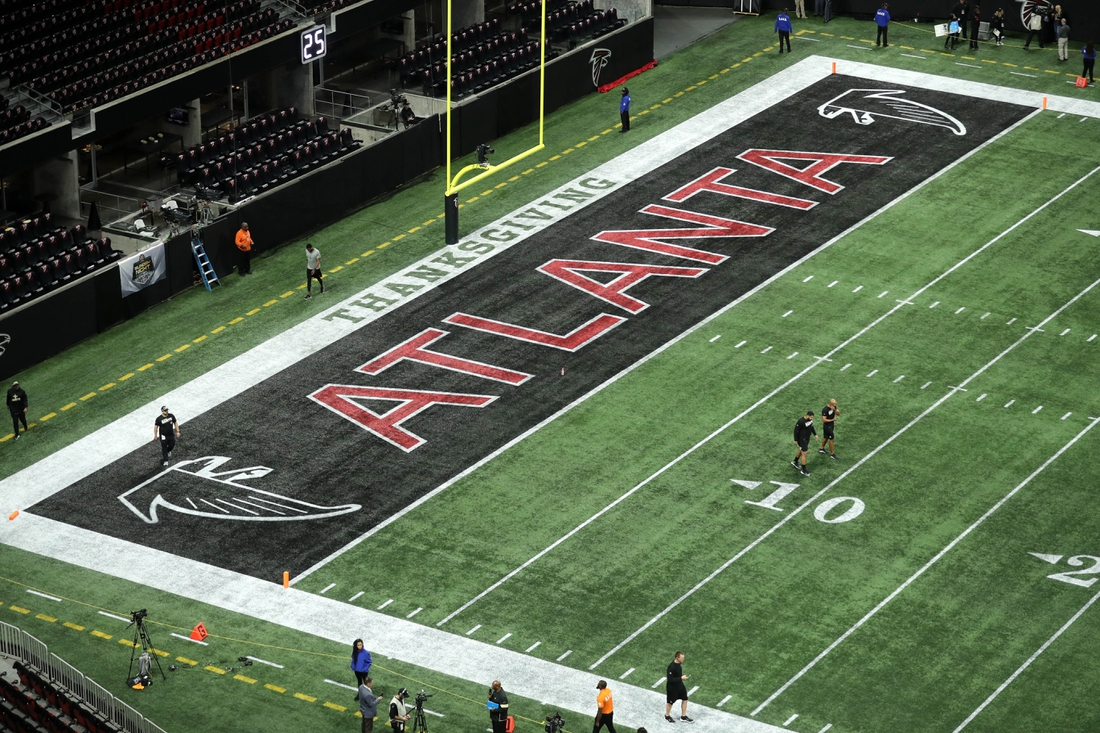 Nov 28, 2019; Atlanta, GA, USA; The Atlanta Falcons logo is shown in an end zone before the game between the New Orleans Saints and the Atlanta Falcons at Mercedes-Benz Stadium. Mandatory Credit: Jason Getz-USA TODAY Sports