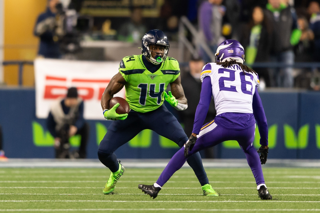 Dec 2, 2019; Seattle, WA, USA; Seattle Seahawks wide receiver D.K. Metcalf (14) and Minnesota Vikings cornerback Trae Waynes (26) during the game at CenturyLink Field. Seattle defeated Minnesota 37-30. Mandatory Credit: Steven Bisig-USA TODAY Sports