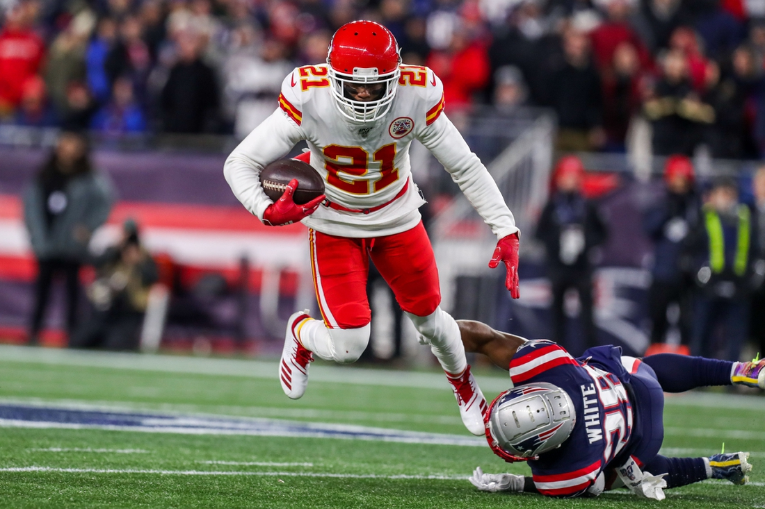 Dec 8, 2019; Foxborough, MA, USA; New England Patriots running back James White (28) tackles Kansas City Chiefs cornerback Bashaud Breeland (21) and Breeland intercepted a pass during the first half at Gillette Stadium. Mandatory Credit: Paul Rutherford-USA TODAY Sports