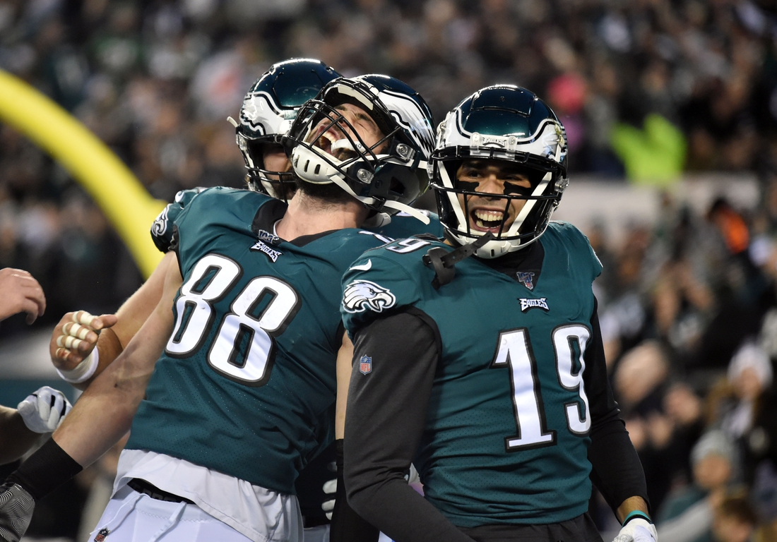 Dec 22, 2019; Philadelphia, Pennsylvania, USA; Philadelphia Eagles tight end Dallas Goedert (88) reacts with after his touchdown catch with wide receiver J.J. Arcega-Whiteside (19) during the first quarter at Lincoln Financial Field. Mandatory Credit: James Lang-USA TODAY Sports