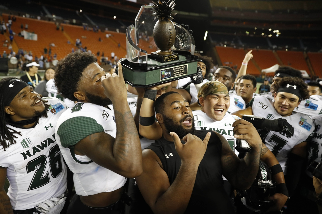 Dec 24, 2019; Honolulu, Hawaii, USA; The Hawaii Warriors hoist the winning trophy at the end of the Hawaii Bowl at Aloha Stadium. The Hawaii Warriors defeated the Brigham Young Cougars 38-34. Mandatory Credit: Marco Garcia-USA TODAY Sports