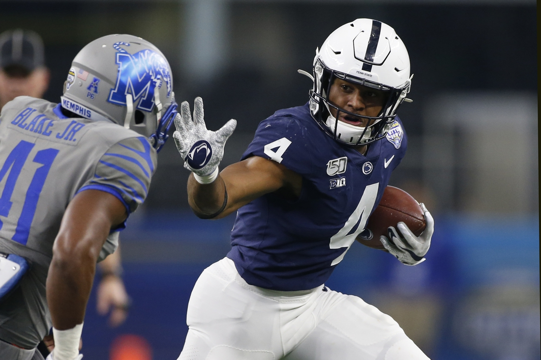 Dec 28, 2019; Arlington, Texas, USA; Penn State Nittany Lions running back Journey Brown (4) runs the ball against Memphis Tigers defensive back Sanchez Blake Jr. (41) in the second quarter at AT&T Stadium. Mandatory Credit: Tim Heitman-USA TODAY Sports