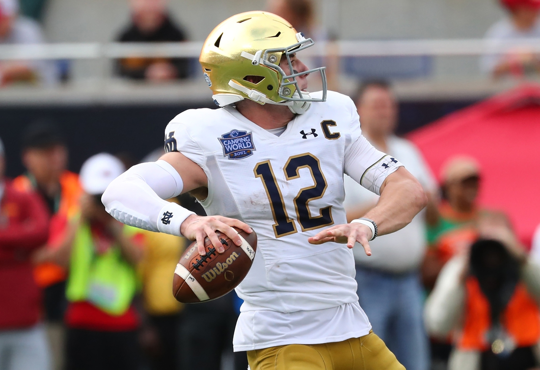 Dec 28, 2019; Orlando, Florida, USA; Notre Dame Fighting Irish quarterback Ian Book (12) throws the ball against the Iowa State Cyclones during the second half at Camping World Stadium. Mandatory Credit: Kim Klement-USA TODAY Sports