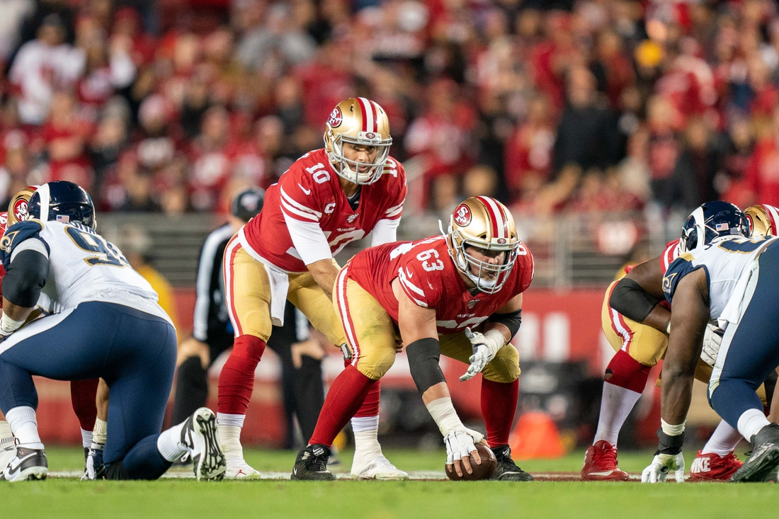 December 21, 2019; Santa Clara, California, USA; San Francisco 49ers quarterback Jimmy Garoppolo (10) and offensive guard Ben Garland (63) during the third quarter against the Los Angeles Rams at Levi's Stadium. Mandatory Credit: Kyle Terada-USA TODAY Sports