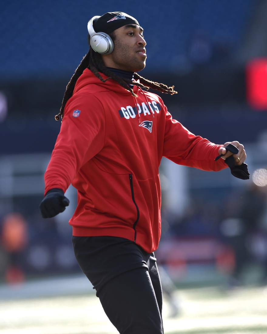 Dec 29, 2019; Foxborough, Massachusetts, USA;  New England Patriots cornerback Stephon Gilmore (24) warms up on the field prior to a game against the Miami Dolphins at Gillette Stadium. Mandatory Credit: Bob DeChiara-USA TODAY Sports