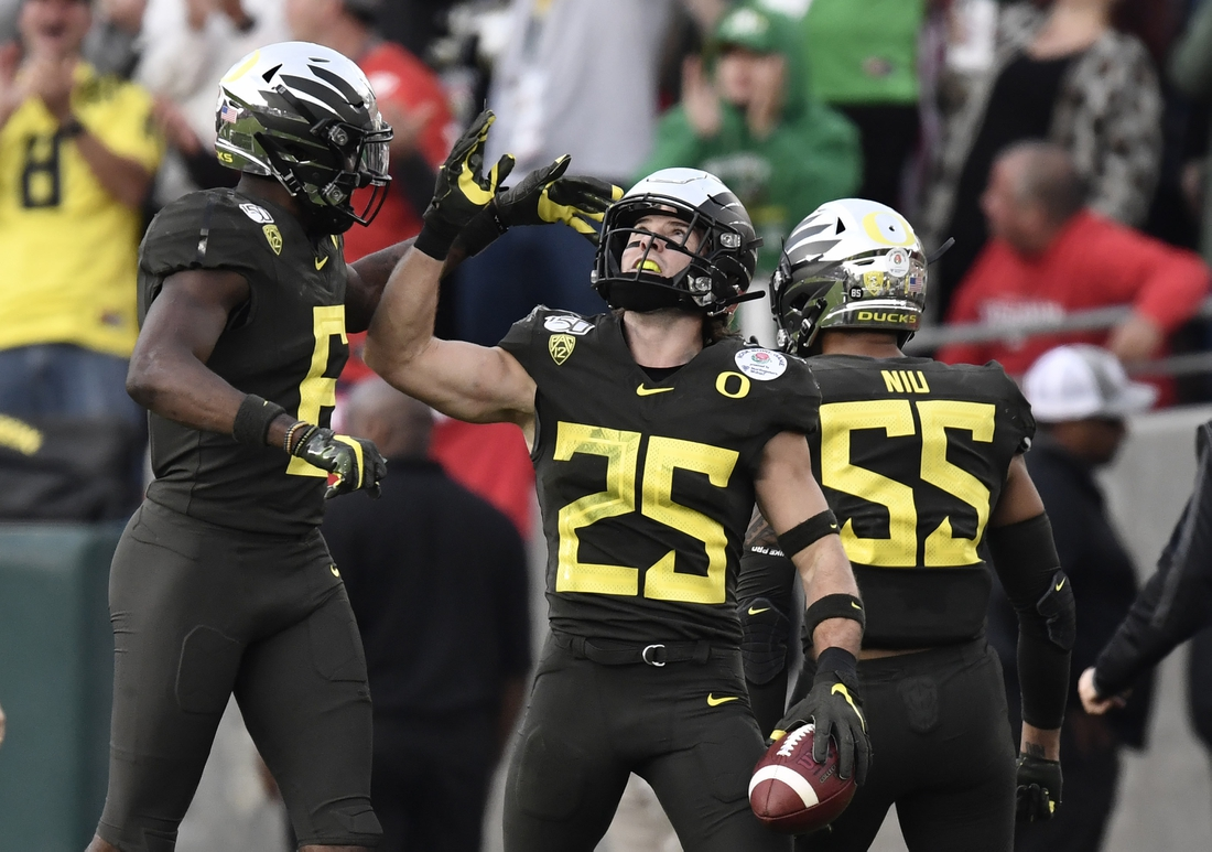 Jan 1, 2020; Pasadena, California, USA; Oregon Ducks safety Brady Breeze (25) celebrates with linebacker Sampson Niu (55) after scoring a touchdown in the third quarter against the Wisconsin Badgers in the 106th Rose Bowl game at Rose Bowl Stadium. Mandatory Credit: Robert Hanashiro-USA TODAY Sports
