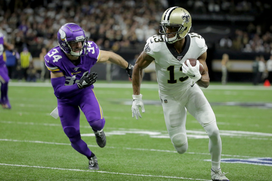 Jan 5, 2020; New Orleans, Louisiana, USA; New Orleans Saints wide receiver Michael Thomas (13) runs after a pass reception against Minnesota Vikings strong safety Andrew Sendejo (34) during the first quarter of a NFC Wild Card playoff football game at the Mercedes-Benz Superdome. Mandatory Credit: Derick Hingle-USA TODAY Sports