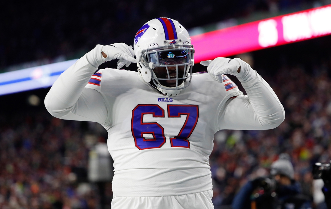 Dec 21, 2019; Foxborough, Massachusetts, USA; Buffalo Bills offensive guard Quinton Spain (67) celebrates a touchdown against the New England Patriots during the second quarter at Gillette Stadium. Mandatory Credit: Winslow Townson-USA TODAY Sports