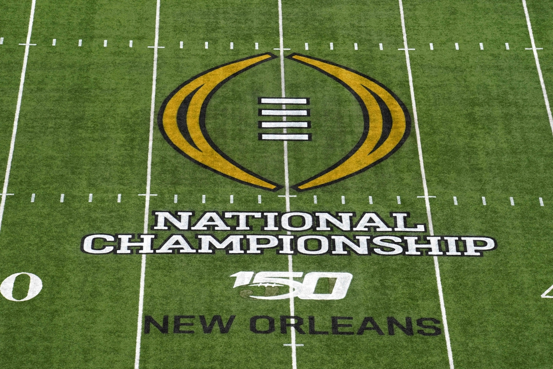 Jan 13, 2020; New Orleans, Louisiana, USA; Detailed view of the 2020 College Football Playoff National Championship logo at midfield at the Mercedes-Benz Superdome. Mandatory Credit: Kirby Lee-USA TODAY Sports