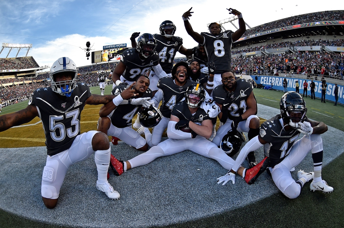 Jan 26, 2020; Orlando, Florida, USA; AFC linebacker T.J. Watt of the Pittsburgh Steelers (90) celebrates his touchdown with teammates against the NFC in the 2020 NFL Pro Bowl at Camping World Stadium. Mandatory Credit: Steve Mitchell-USA TODAY Sports