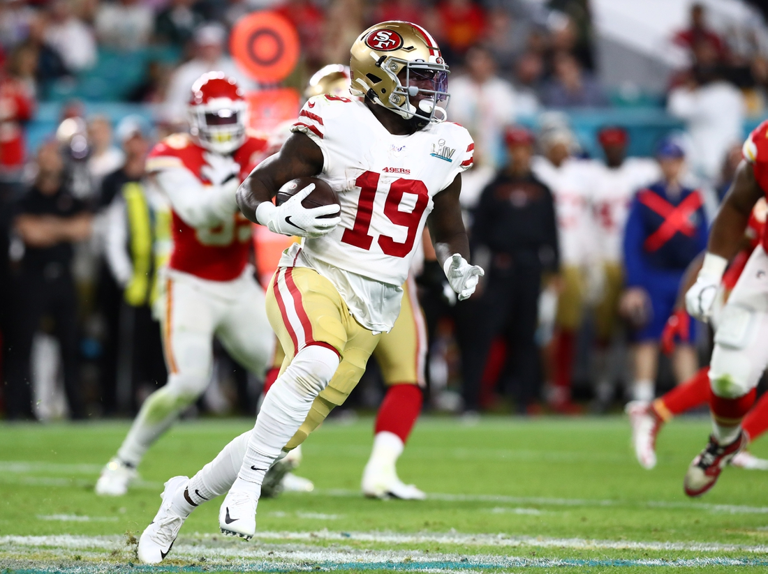 Feb 2, 2020; Miami Gardens, Florida, USA; San Francisco 49ers receiver Deebo Samuel (19) runs with the ball against the Kansas City Chiefs in Super Bowl LIV at Hard Rock Stadium. Mandatory Credit: Matthew Emmons-USA TODAY Sports