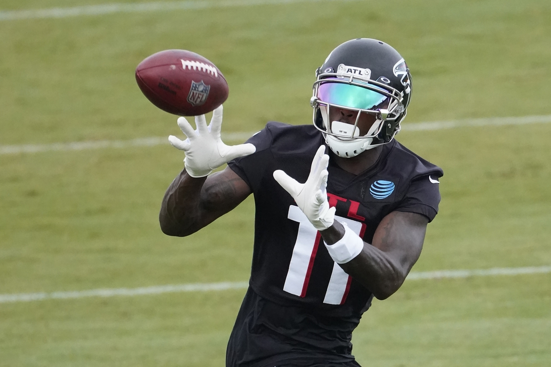 Aug 23, 2020; Atlanta, GA, USA; Atlanta Falcons wide receiver Julio Jones (11) makes a catch during an NFL training camp football practice Sunday, Aug. 23, 2020, in Atlanta.  Mandatory Credit: John Bazemore/Pool Photo-USA TODAY Sports