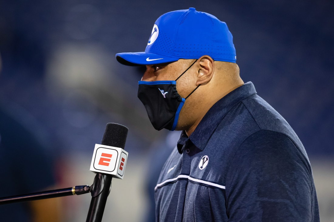 Sep 7, 2020; Annapolis, Maryland, USA; Brigham Young Cougars head coach Kalani Sitake is interviewed by a socially distanced ESPC microphone after the first half of the game against the Navy Midshipmen at Navy-Marine Corps Memorial Stadium. Mandatory Credit: Scott Taetsch-USA TODAY Sports