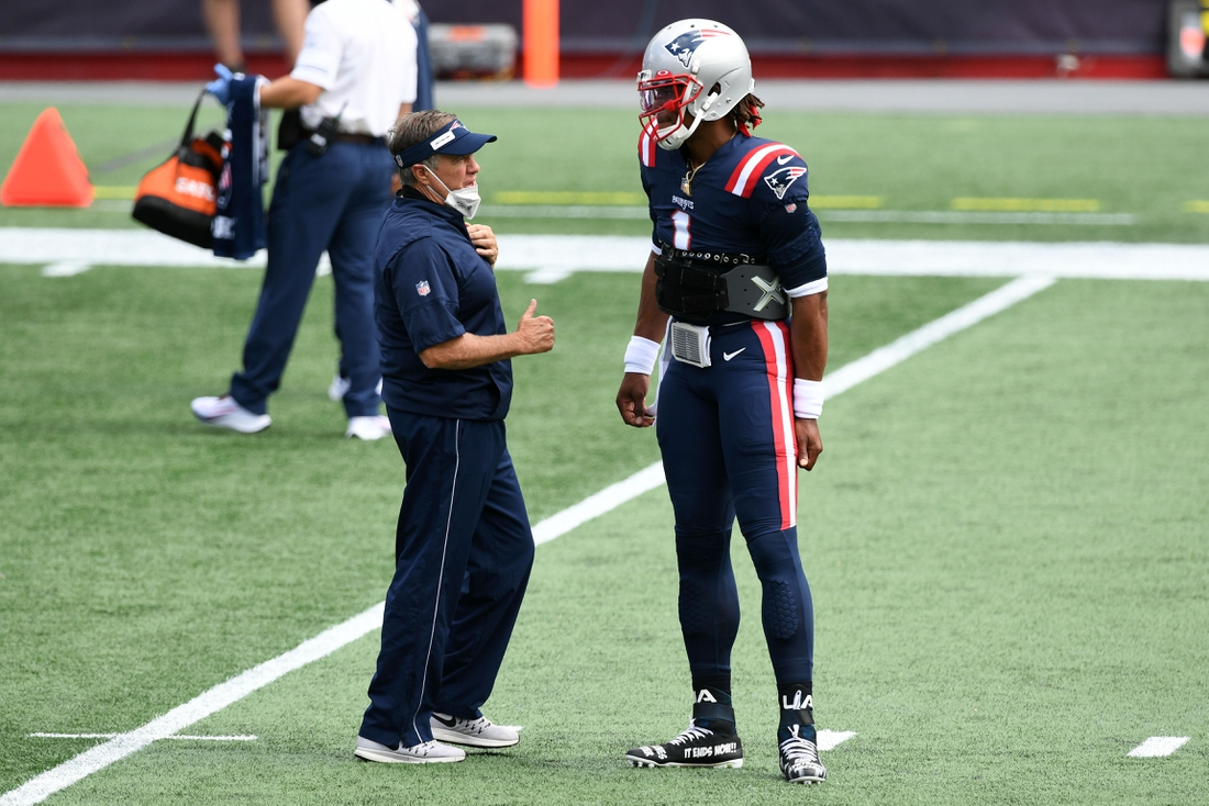 Sep 13, 2020; Foxborough, Massachusetts, USA; New England Patriots head coach Bill Belichick talks with quarterback Cam Newton (1) before a game against the Miami Dolphins at Gillette Stadium. Mandatory Credit: Brian Fluharty-USA TODAY Sports