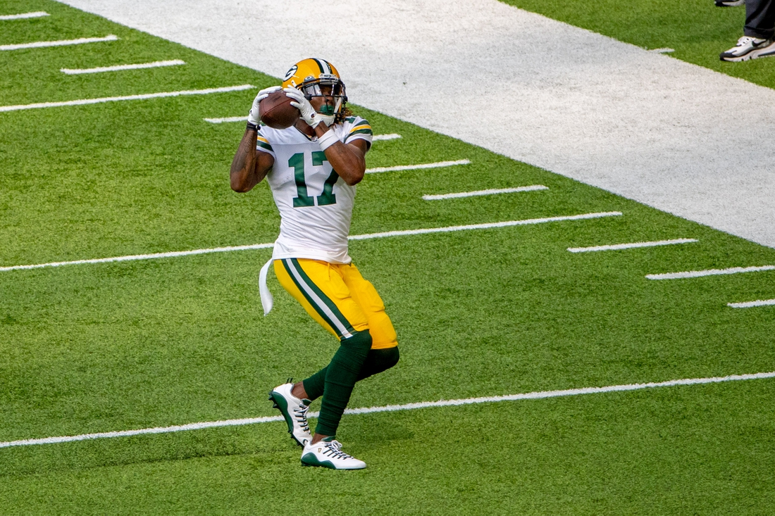 Sep 13, 2020; Minneapolis, Minnesota, USA Green Bay Packers wide receiver Davante Adams (17) catches a pass in the first quarter against the Minnesota Vikings at U.S. Bank Stadium. Mandatory Credit: Jesse Johnson-USA TODAY Sports